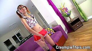 Pigtailed skinny Thai teen gets pussy creampie