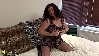 Cheerful British mother getting wet on a dildo