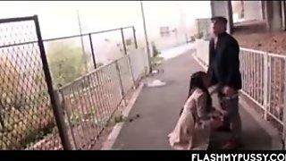 Cunt flashing Asian slut taking two horny dicks in public